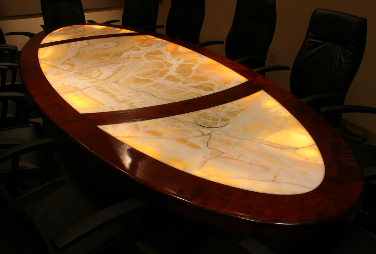 photo of a tiger maple confrence table with light that